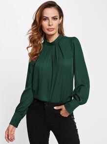Blusa plisada con cuello mao