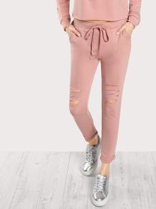 Sweat-pantalons lacéré avec lacet