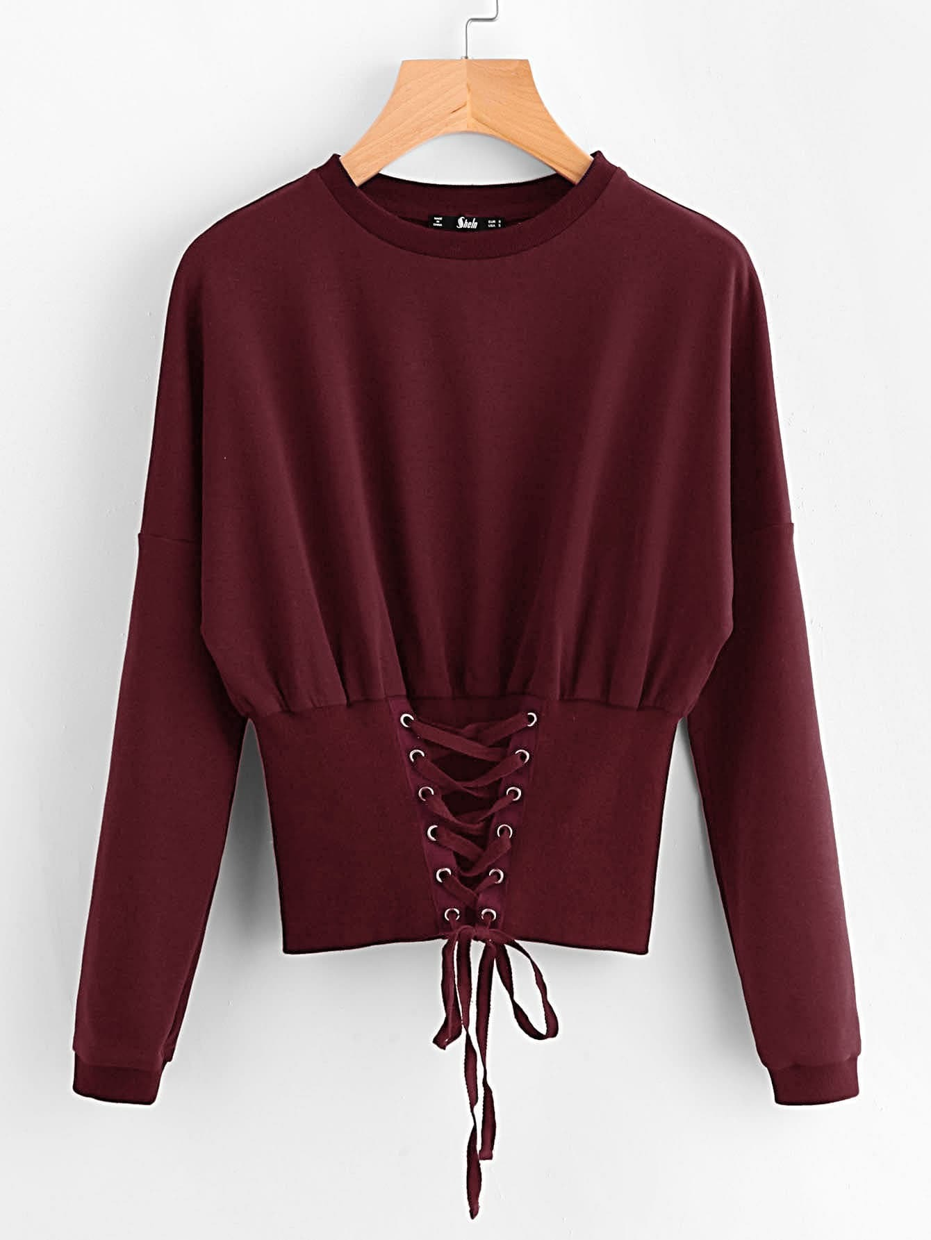 Grommet Lace Up Wide Hem Sweatshirt