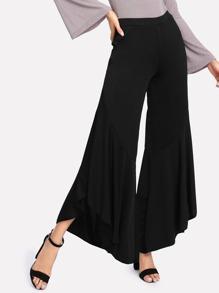 Pantalons évasé bord asymétrique