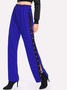 Pantalons avec jambe gros divisé côté avec perle fausse