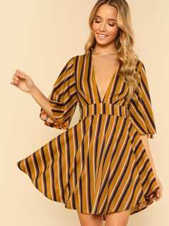 Bell Sleeve Plunging Curved Hem Dress