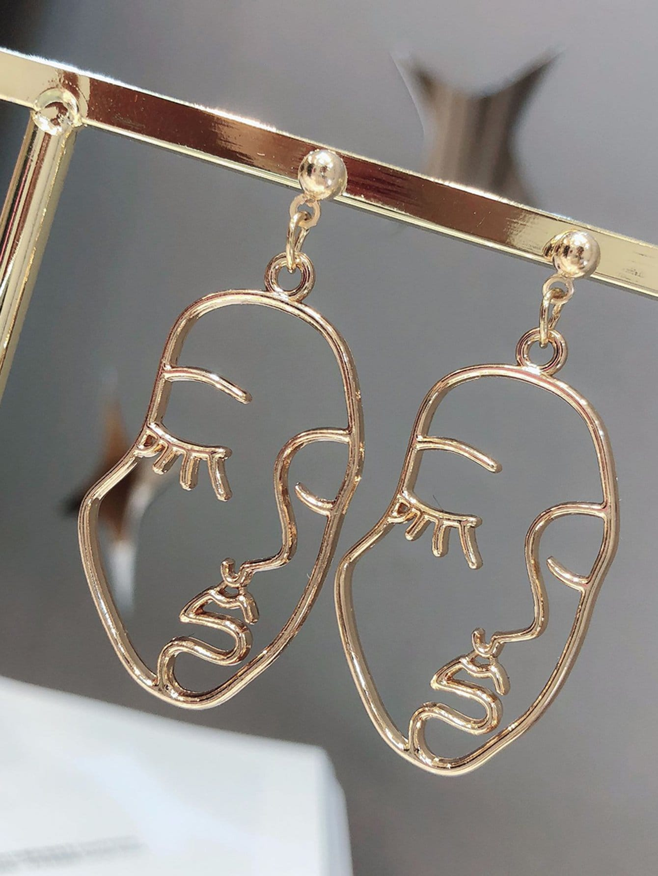 Hollow Face Design Drop Earrings