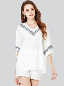 Graphic Embroidered Tie Neck Top