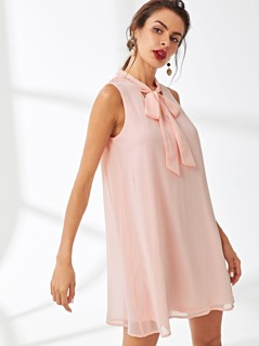 Tied Neck Sleeveless Swing Dress