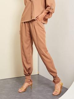 Adjustable Belted Hem Solid Pants