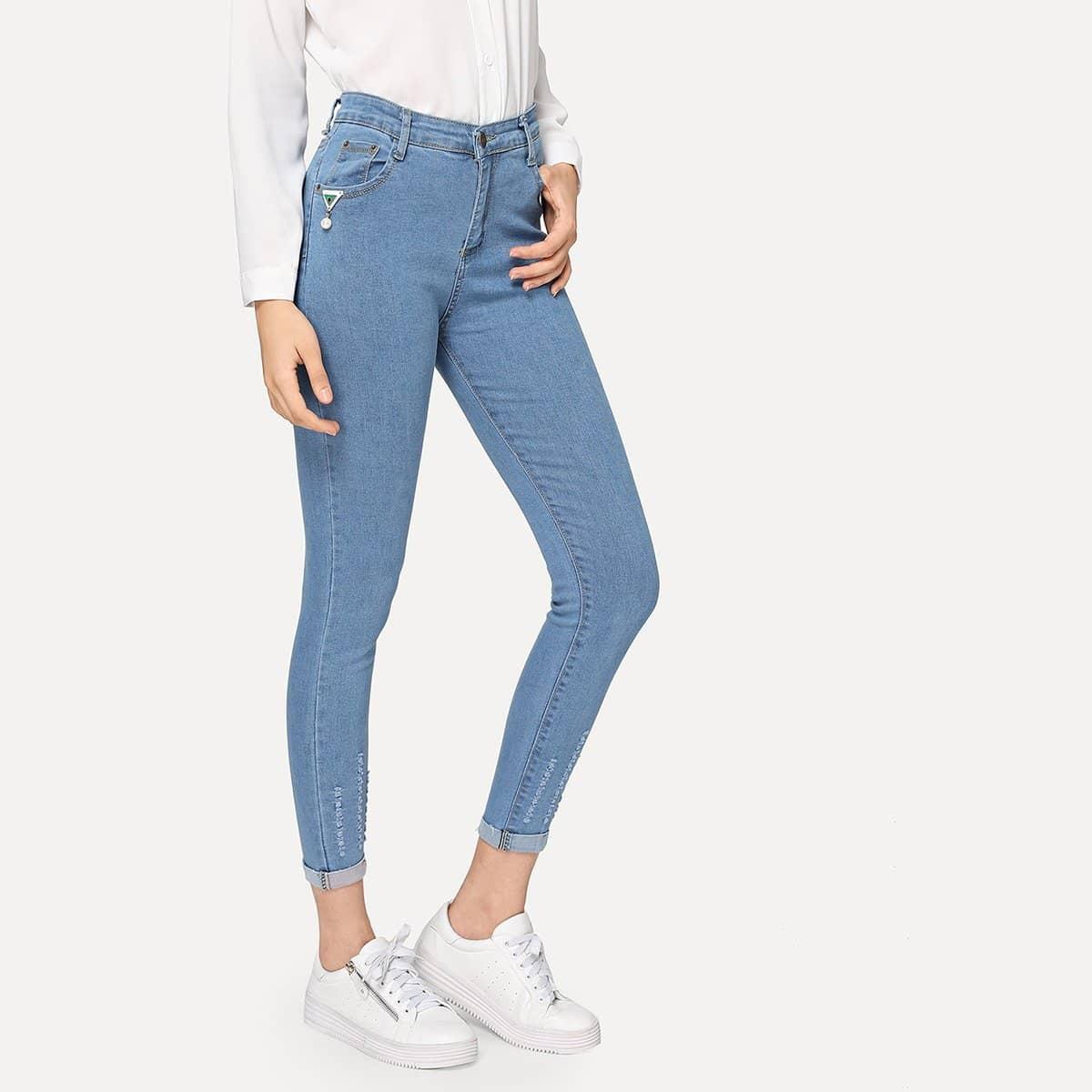 Gescheurde skinny jeans met opgerolde pijpen