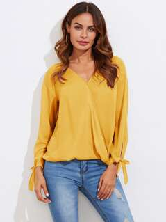 Bowed Cuff Curved Hem Surplice Wrap Blouse