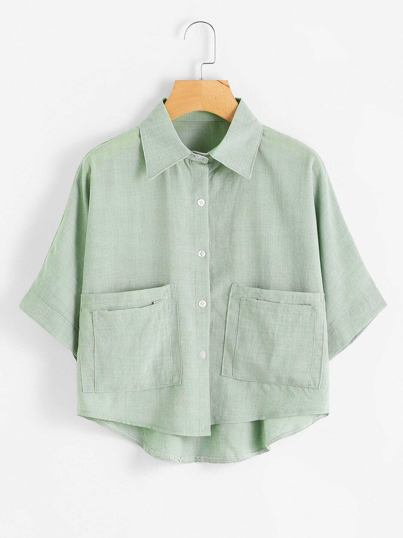Bluse mit abfallendem Saum und duale Taschen vorn