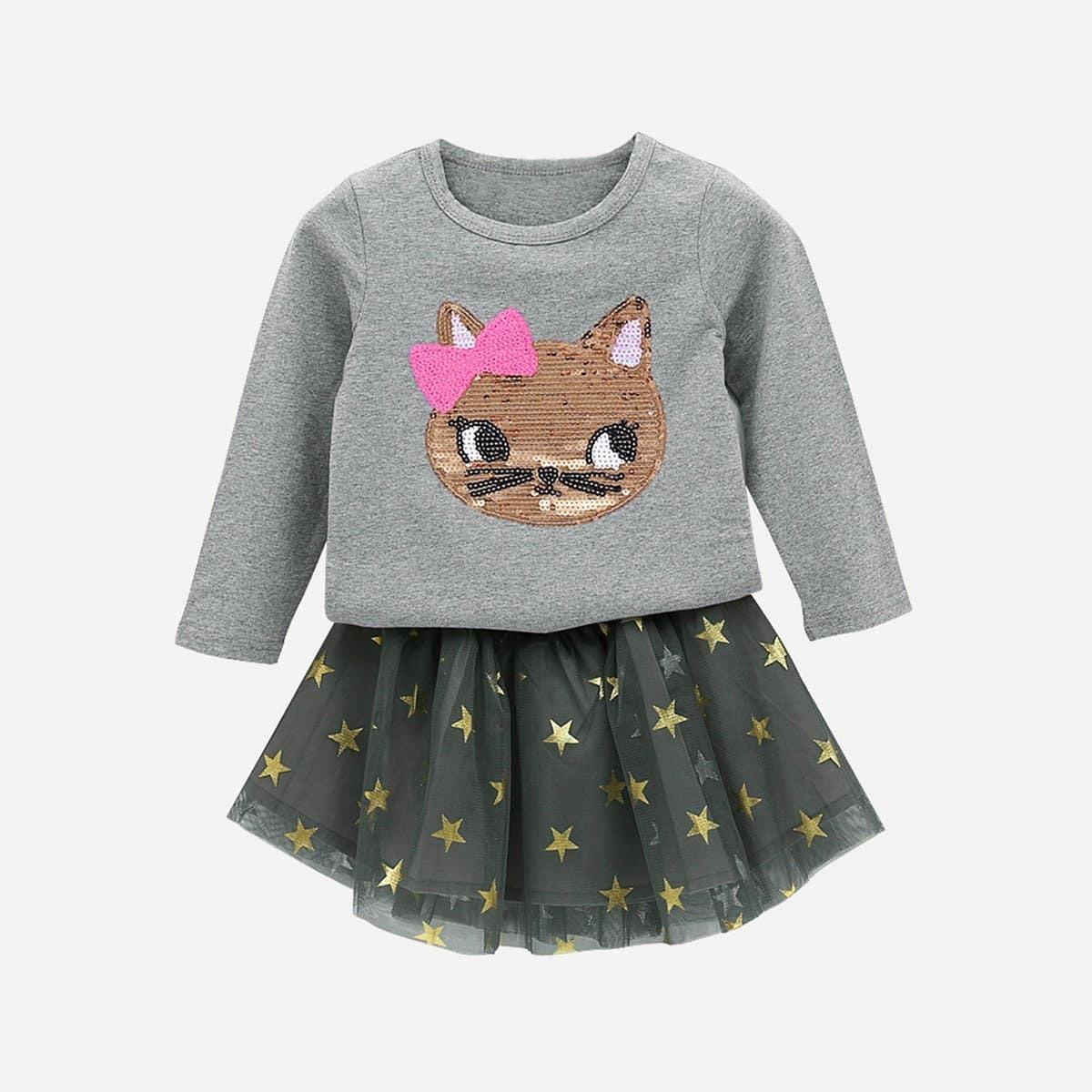 Sweater met pailletten kat en gazen rok met sterrenprint