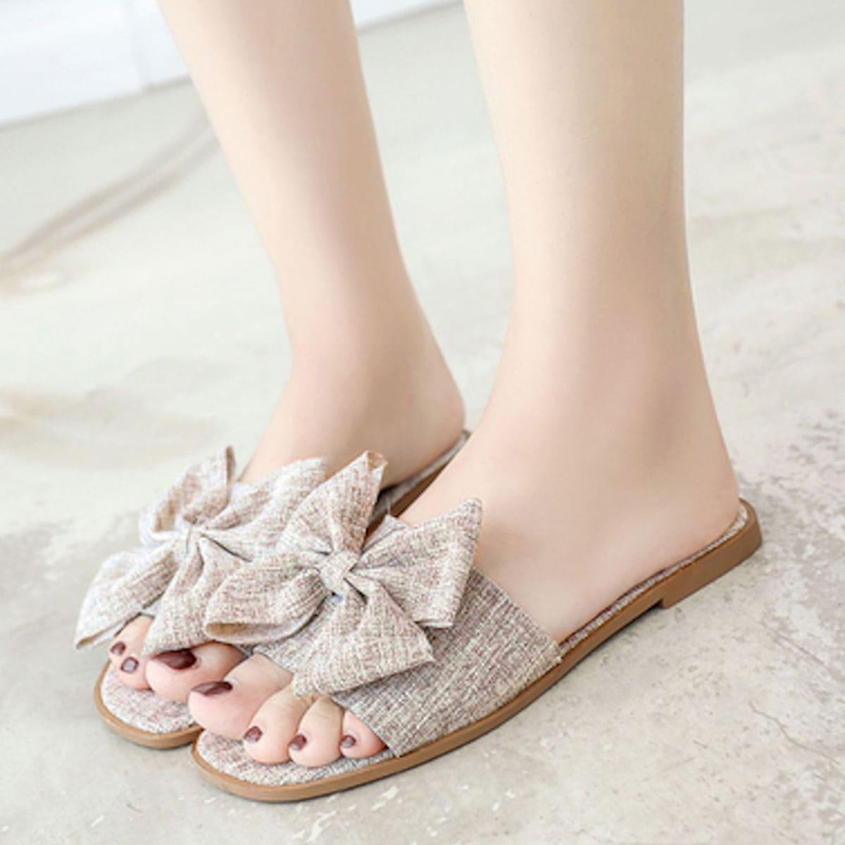 Boog versierde platte slippers