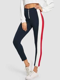 Cut-and-sew O-Ring Zipper Pants