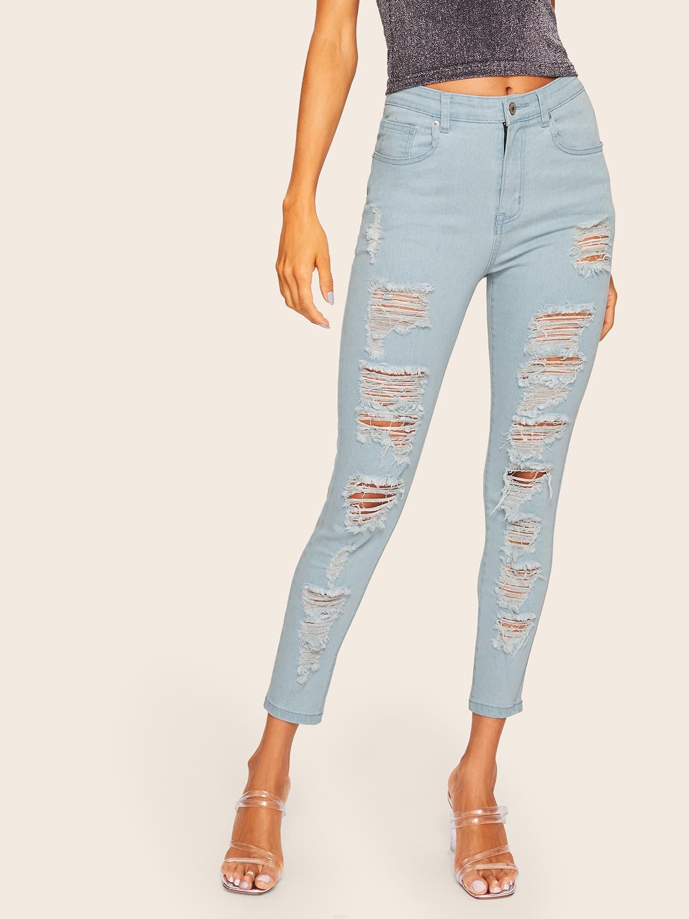 Рваные джинсы со складкой