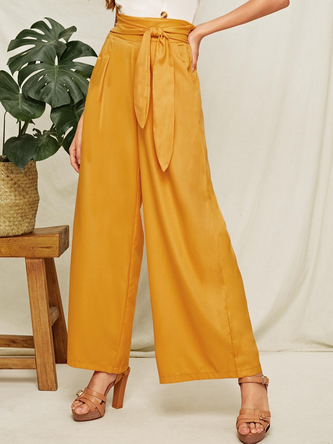 Фото - Широкие брюки с карманом и поясом от SheIn желтого цвета