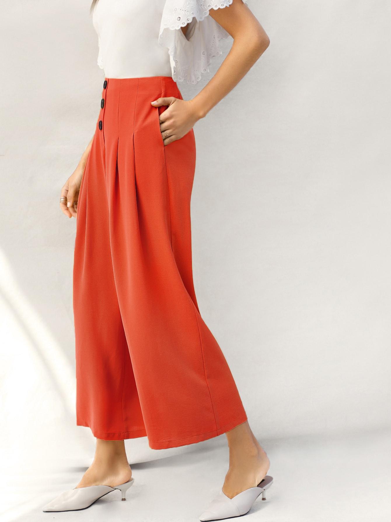 Фото - Неоновые оранжевые широкие брюки от SheIn оранжевого цвета