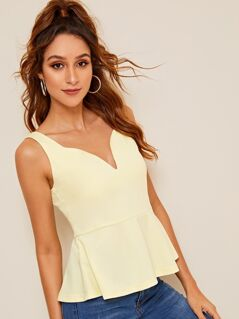 Zip Back Solid Peplum Top