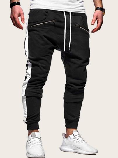 26f64a270304 Pantalones deportivos de hombres de cintura con cordón de lado de rayas