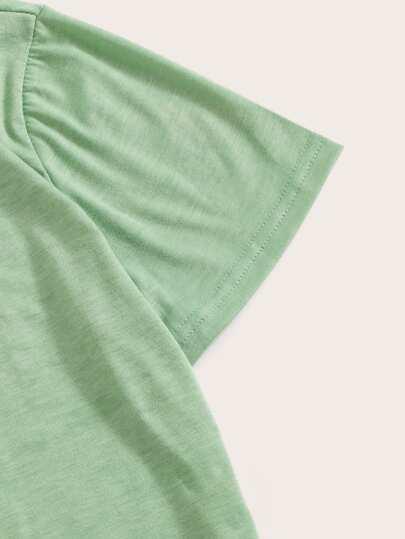 Фото 9 - Комбинезон на бретелях с поясом, тропическим принтом и глубоким V-образным вырезом от SheIn цвет многоцветный