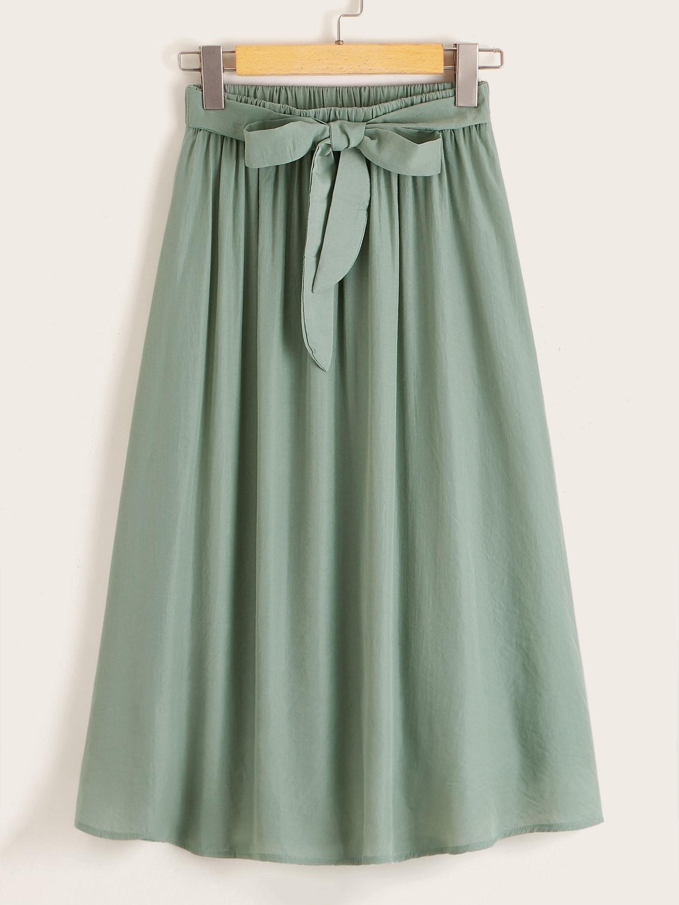 Фото - Однотонная расклешенная юбка с узлом от SheIn зеленого цвета
