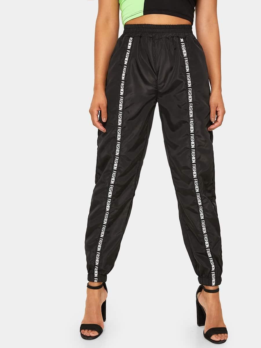 Фото - Спортивные брюки с эластичной талией от SheIn черного цвета