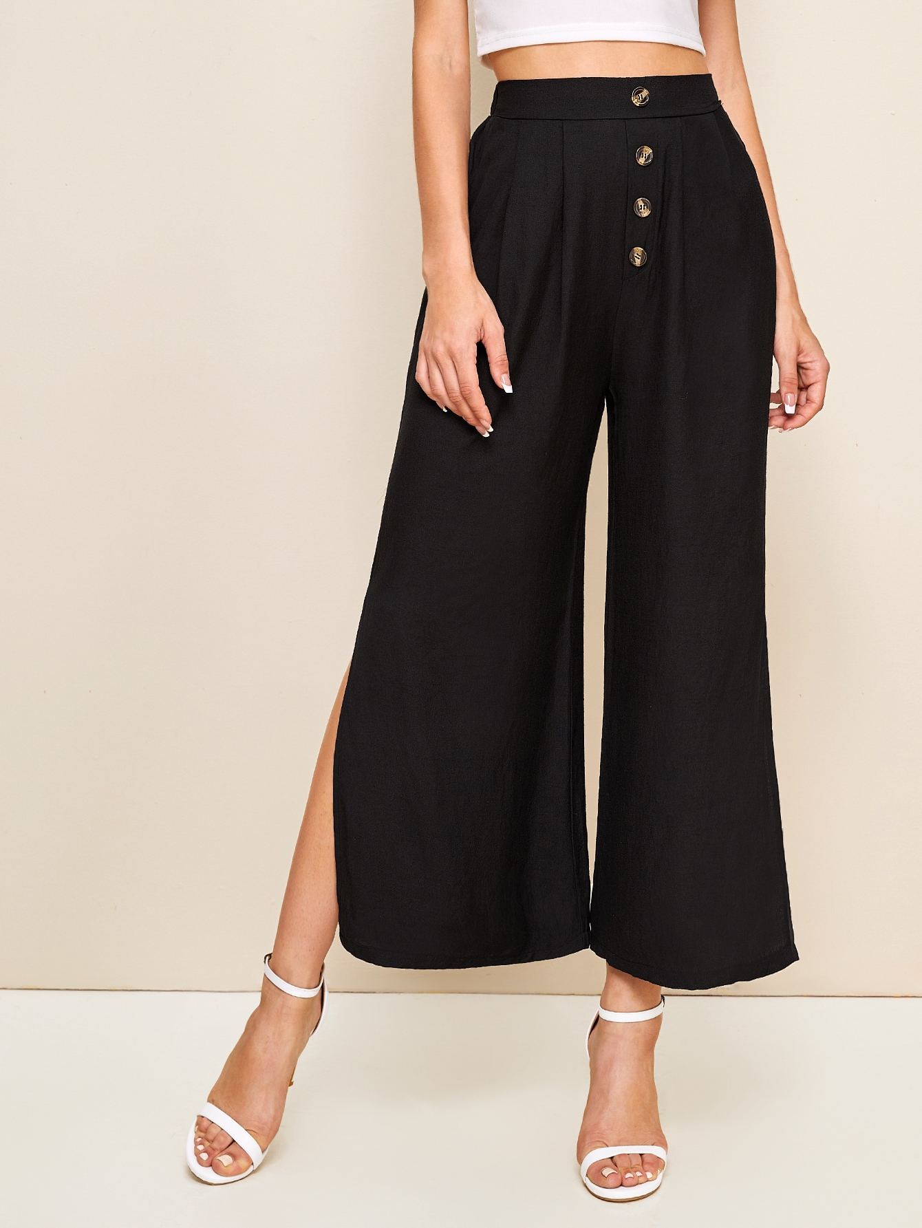 Фото - Широкие брюки с разрезом и пуговицами от SheIn черного цвета