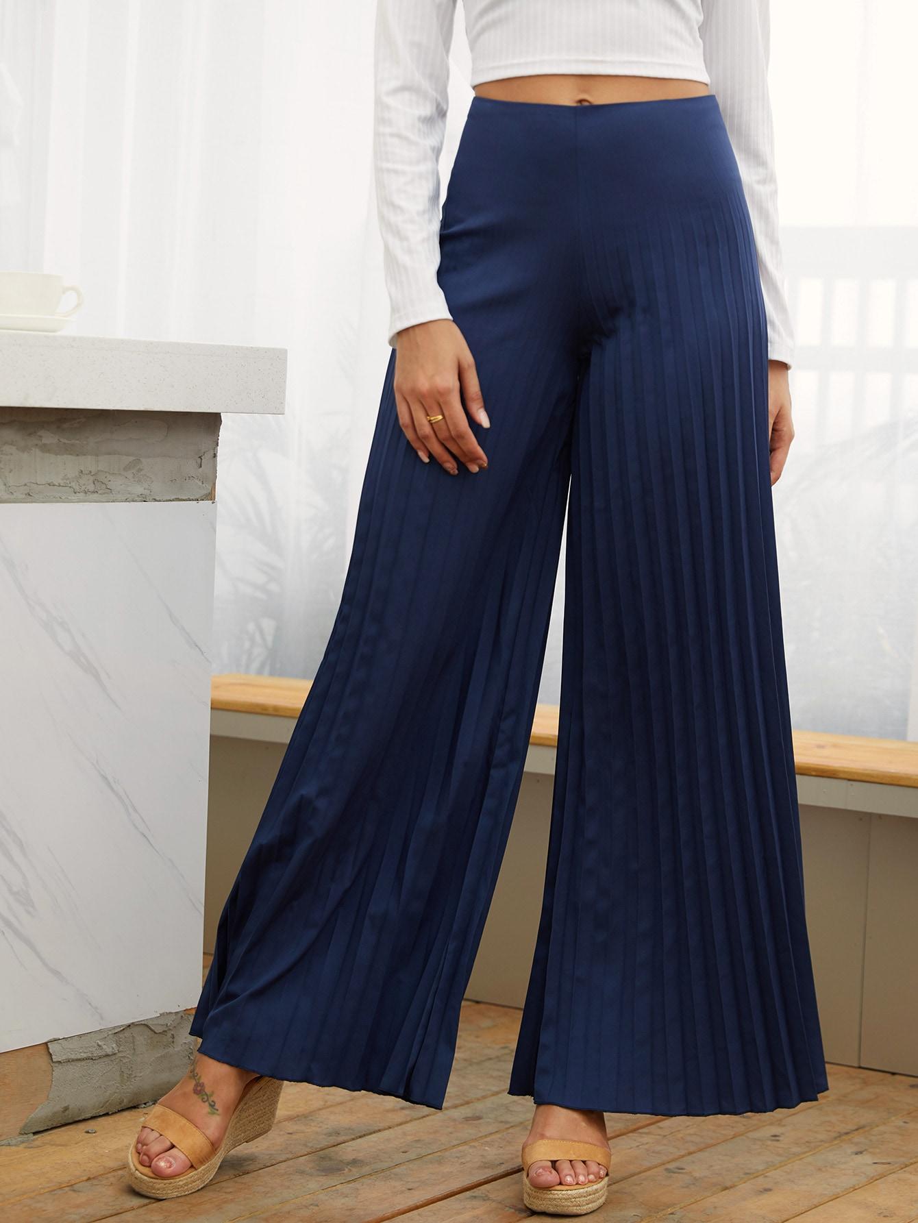 Широкие плиссированные брюки