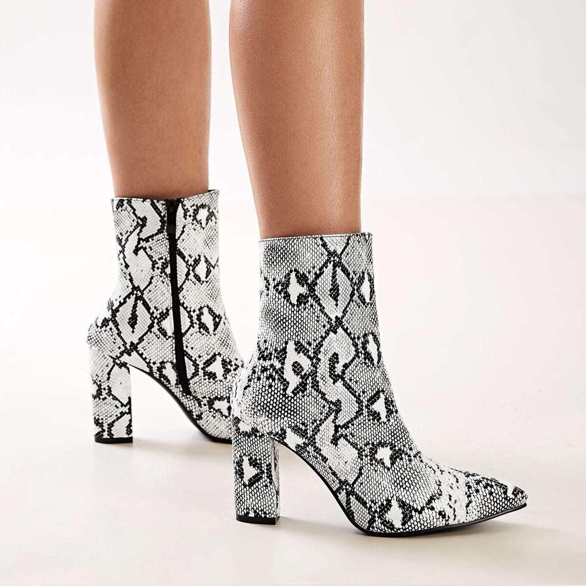 Laarzen met slangenprint, dikke hak en zijrits