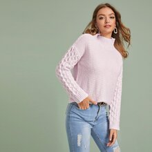 Pull en tricot torsadé à col montant