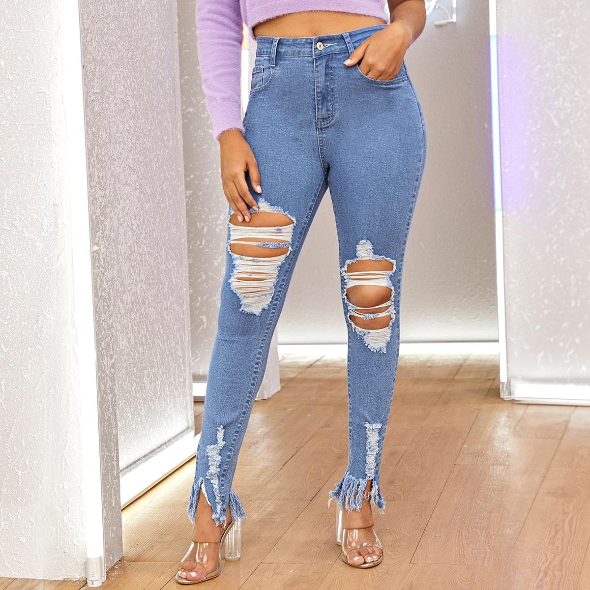Рваные джинсы с необработанным низом и бахромой