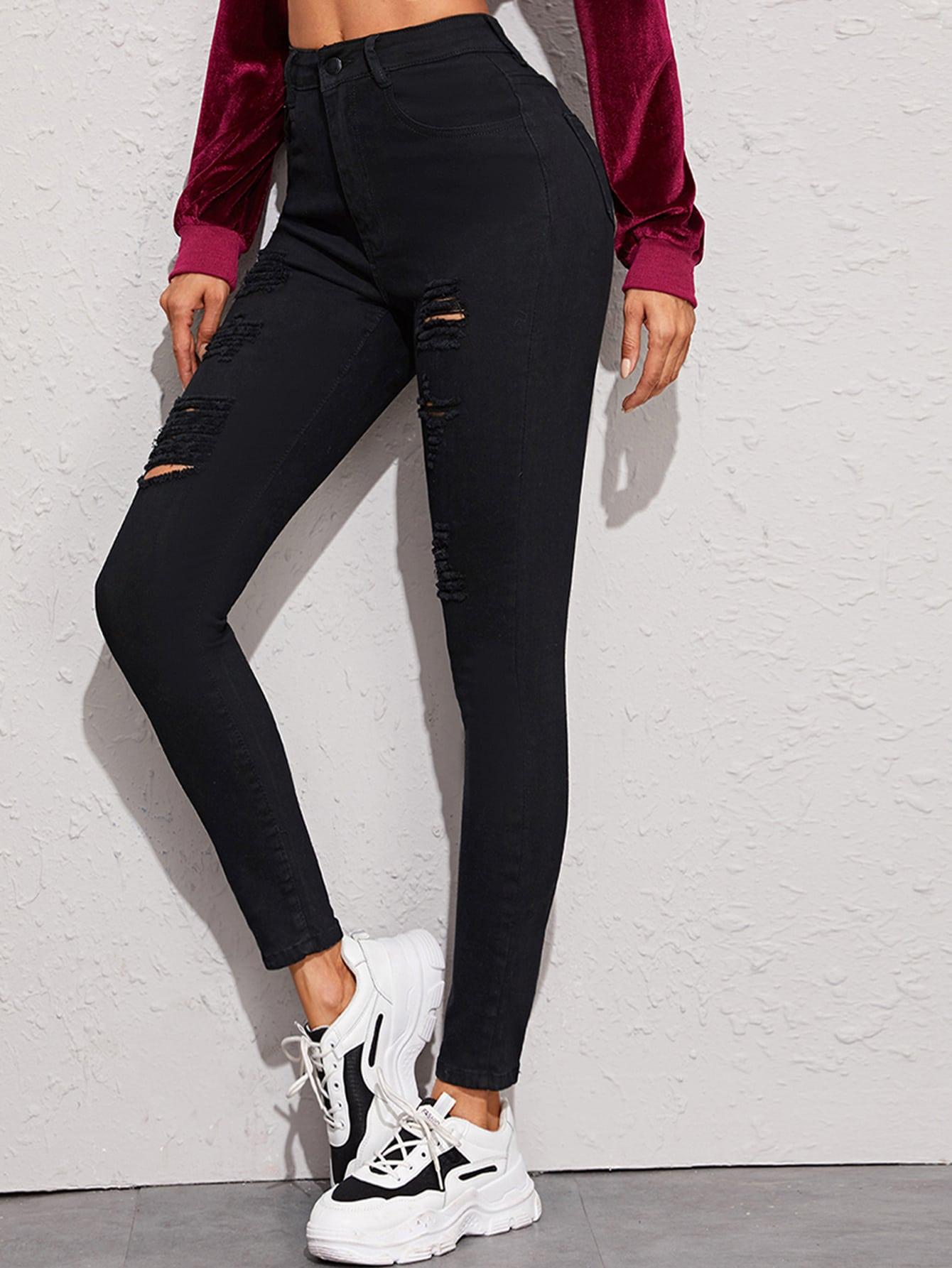 Однотонные рваные джинсы с пуговицами
