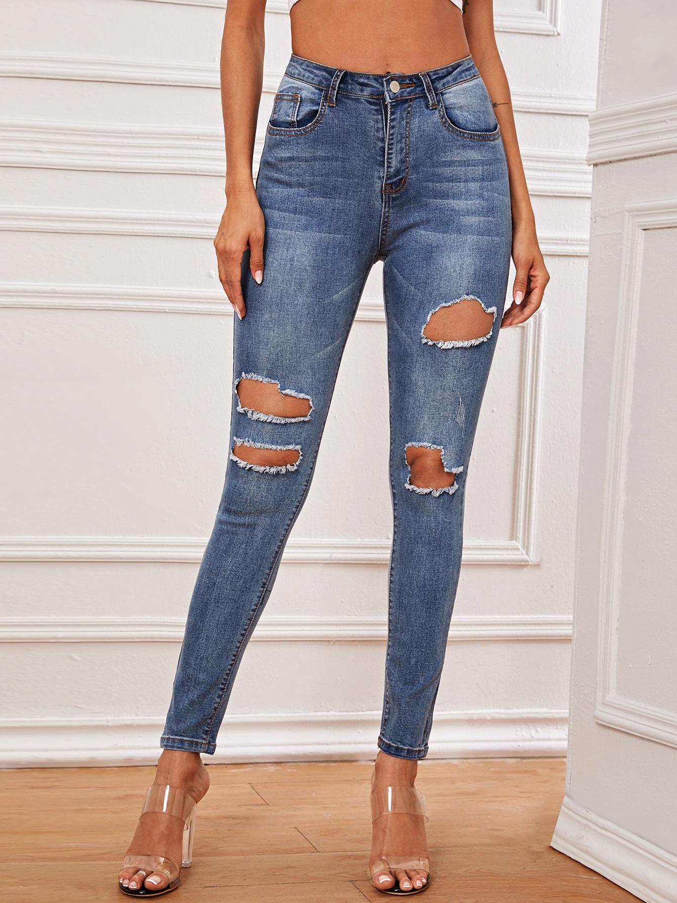 Рваные джинсы с карманами