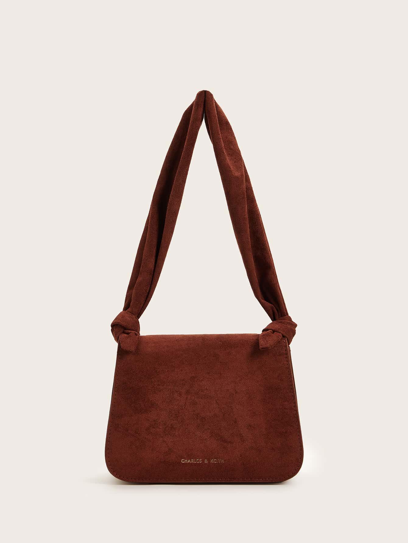 Замшевая сумка с узлом на ремне