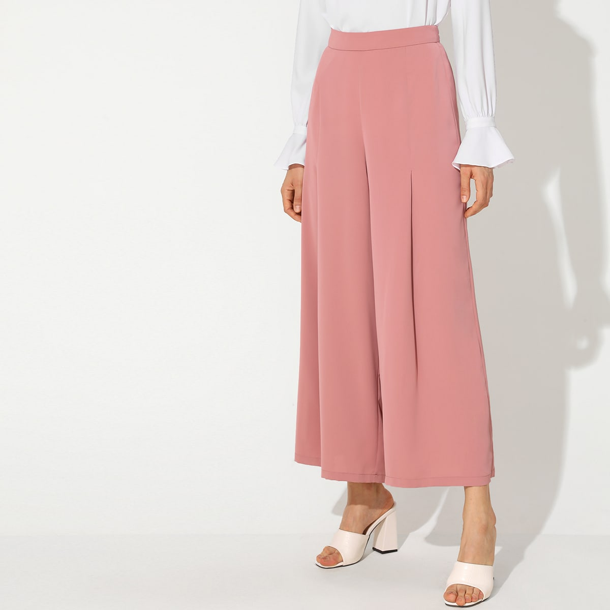 Широкие брюки со складкой фото