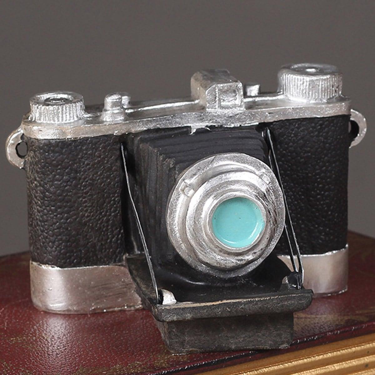 Cameravormig decoratief object