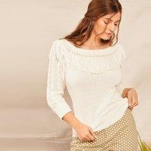 Pull en tricot avec franges