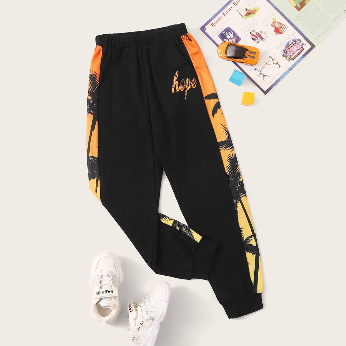 Спортивные брюки с тропическим принтом для мальчиков от SHEIN