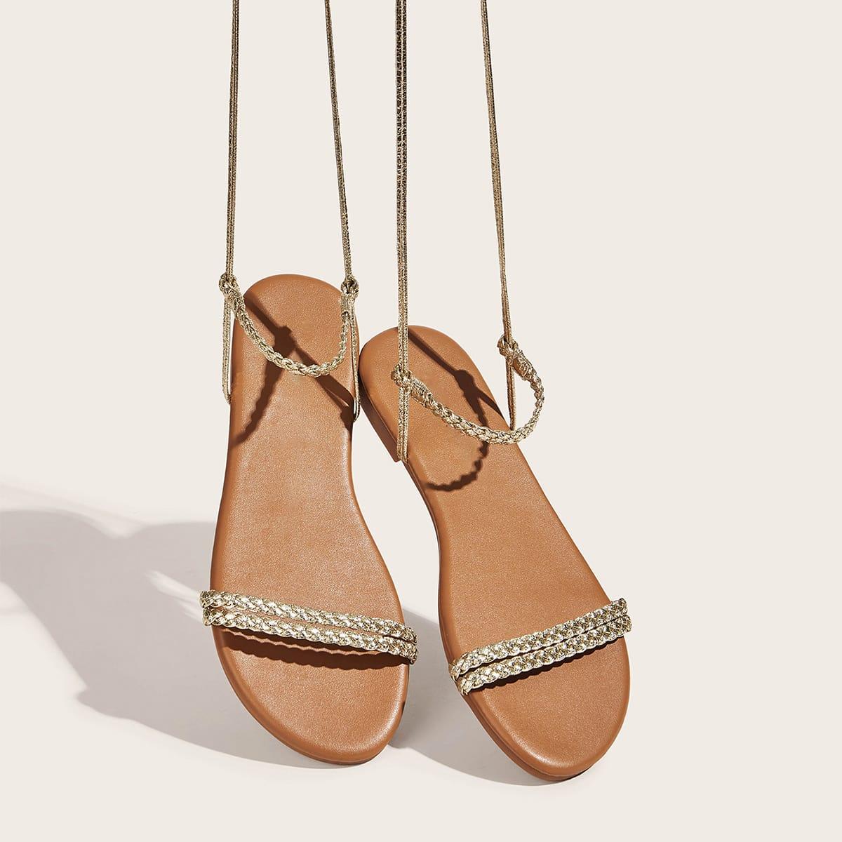 Gevlochten sandalen met strikband