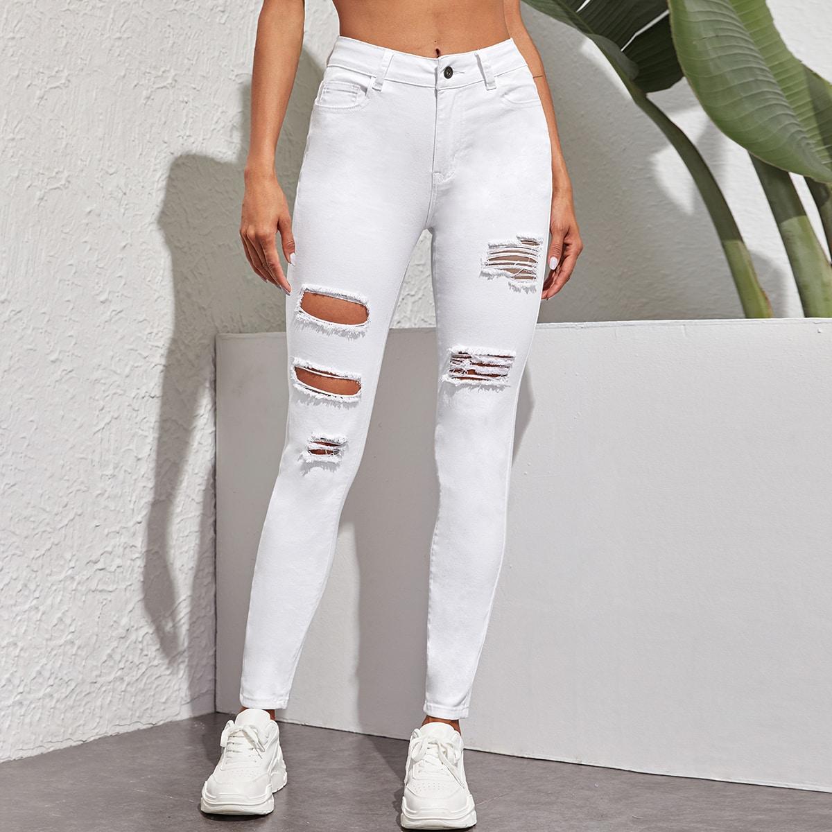 Однотонные рваные джинсы