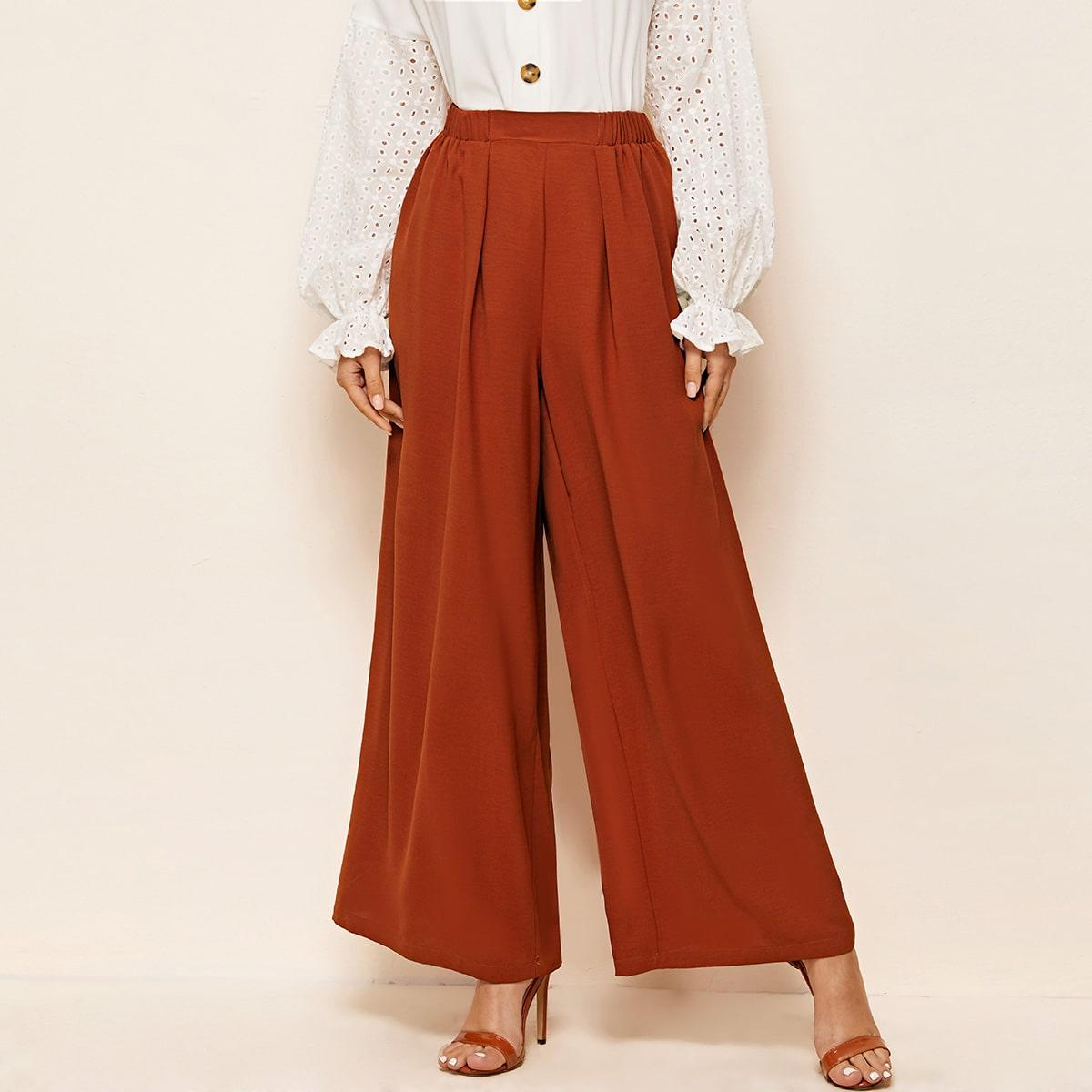 Плиссированные широкие брюки фото