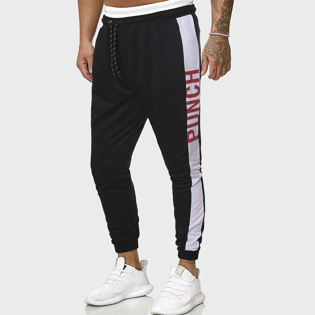 Мужские спортивные брюки с текстовым принтом и боковым швом фото
