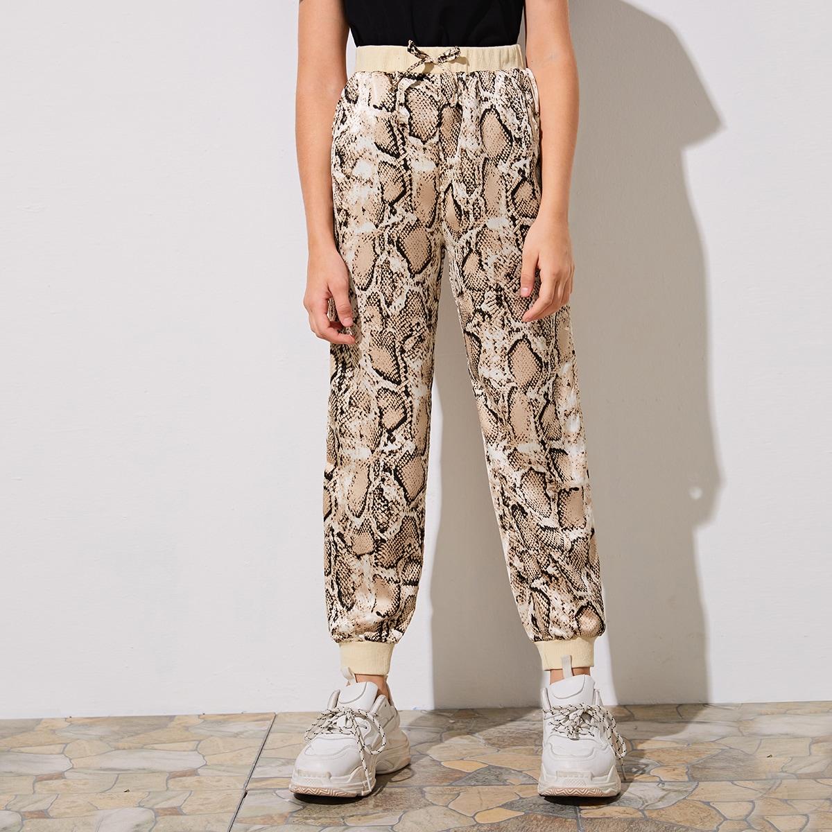 SHEIN / Pantalones de niñas con estampado de piel de serpiente de cintura y bajo de canalé