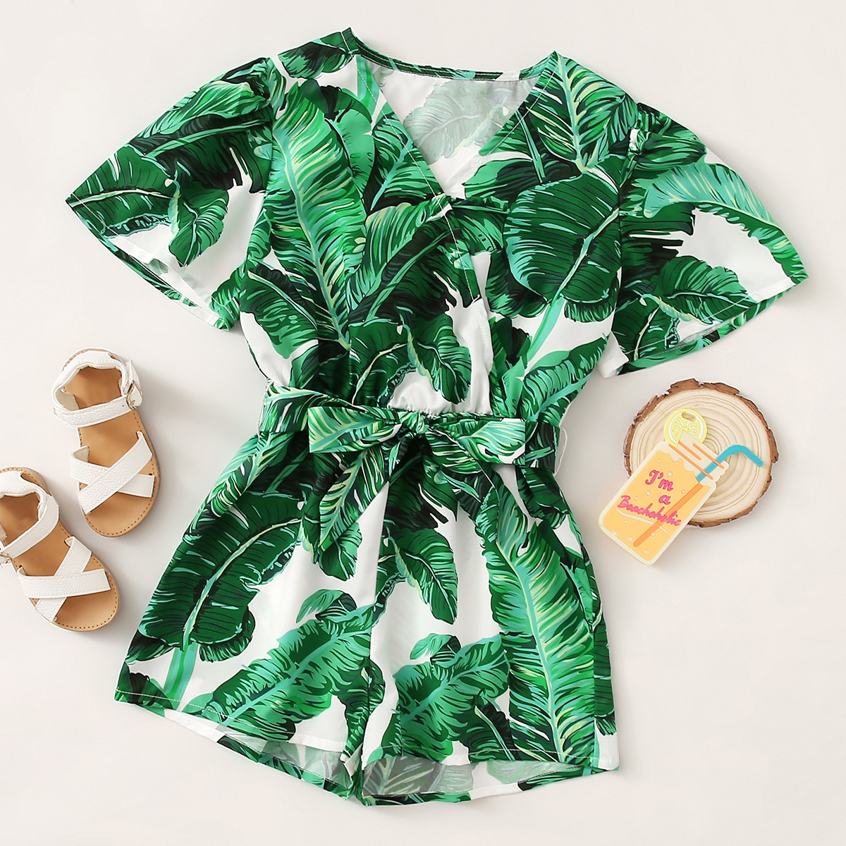 SHEIN / Girls Surplice Neck Self Belted Tropical Print Romper