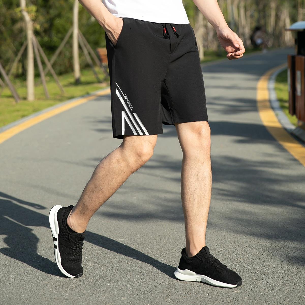 SHEIN / Shorts con estampado de rayas y letra