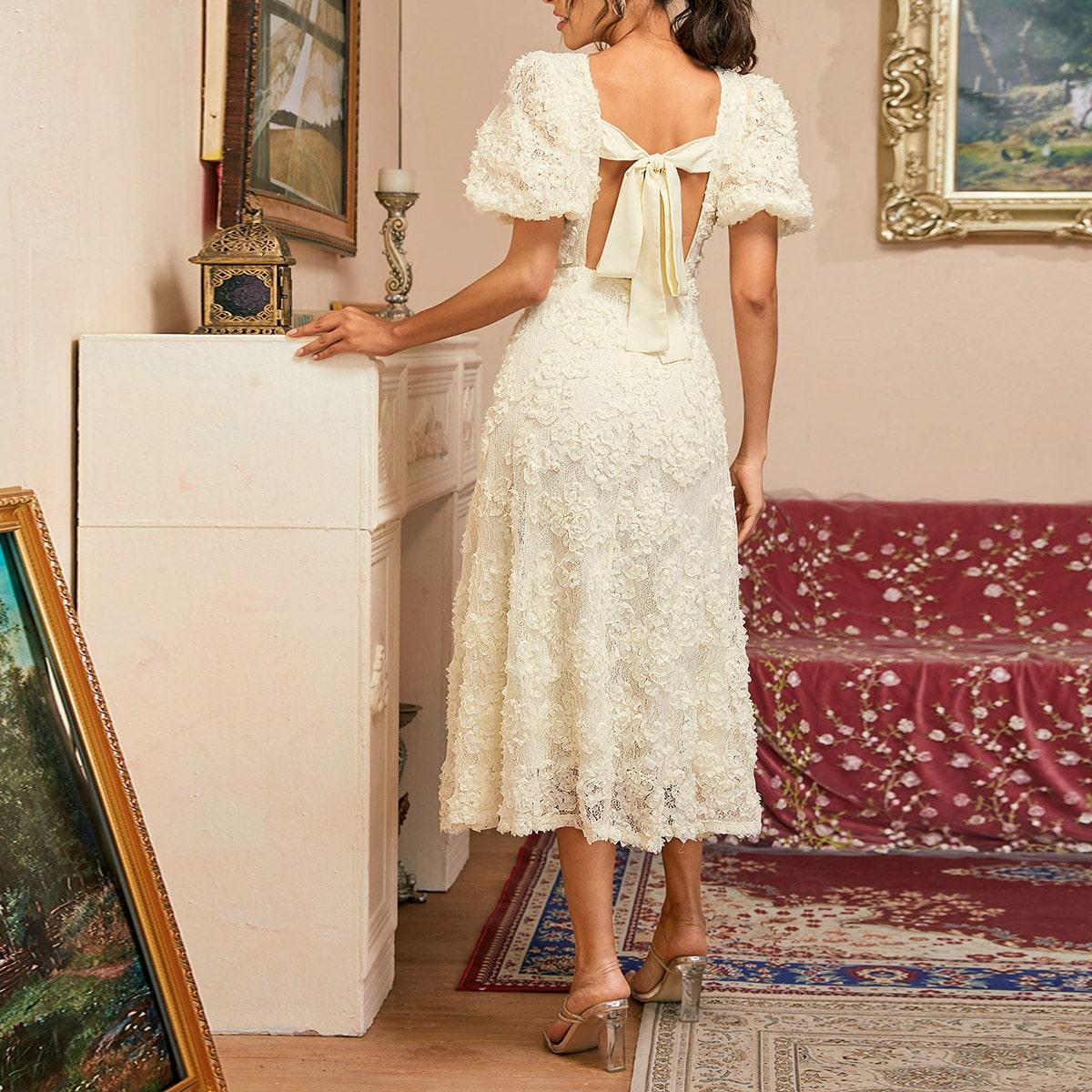Кружевное платье с пышным рукавом и узлом сзади фото