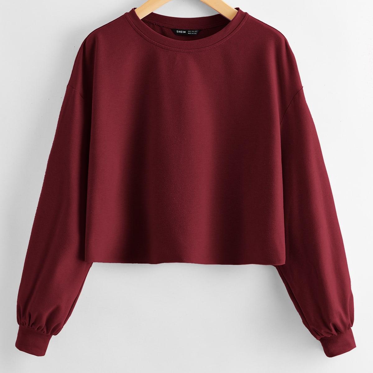 Короткий пуловер со спущенным рукавом фото