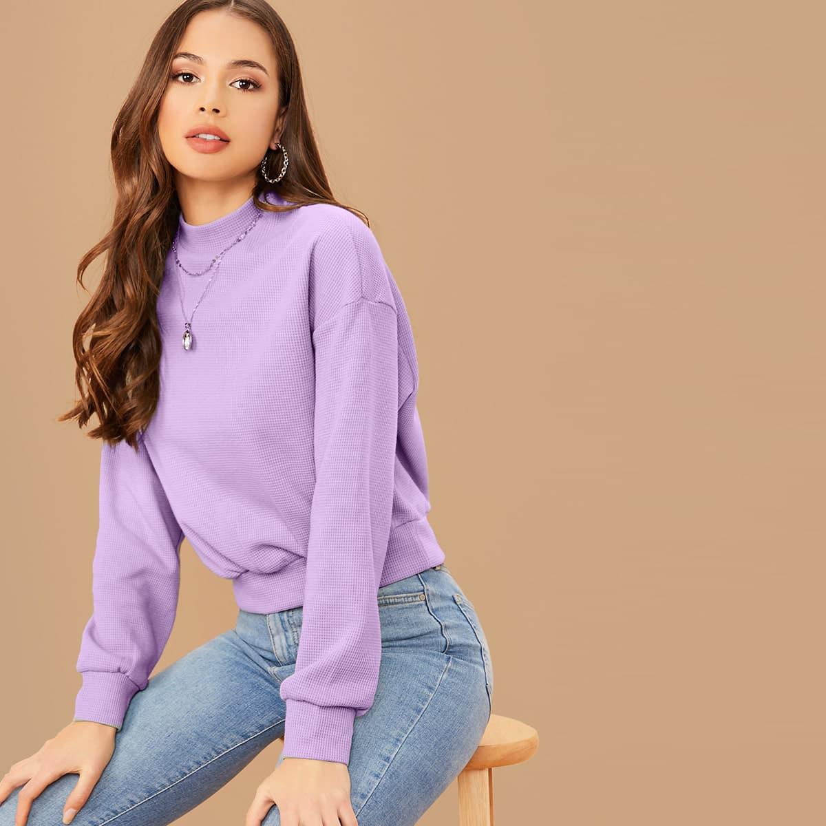 Трикотажный пуловер с воротником-стойкой фото