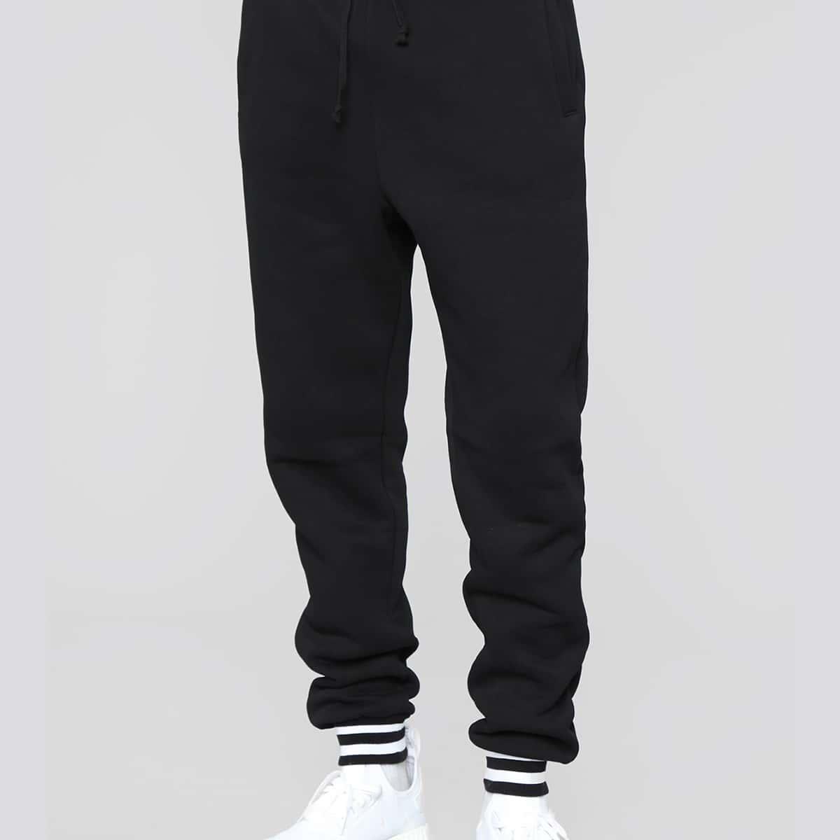 Pantalones deportivos de cintura con cordón ribete de rayas