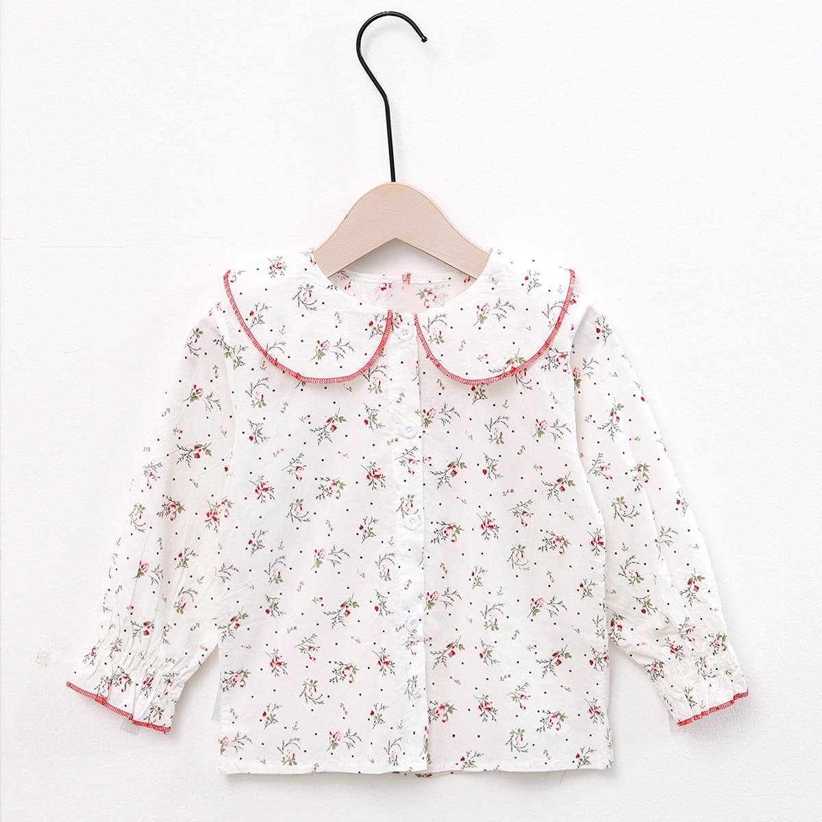 Блузка с пуговицами и цветочным принтом