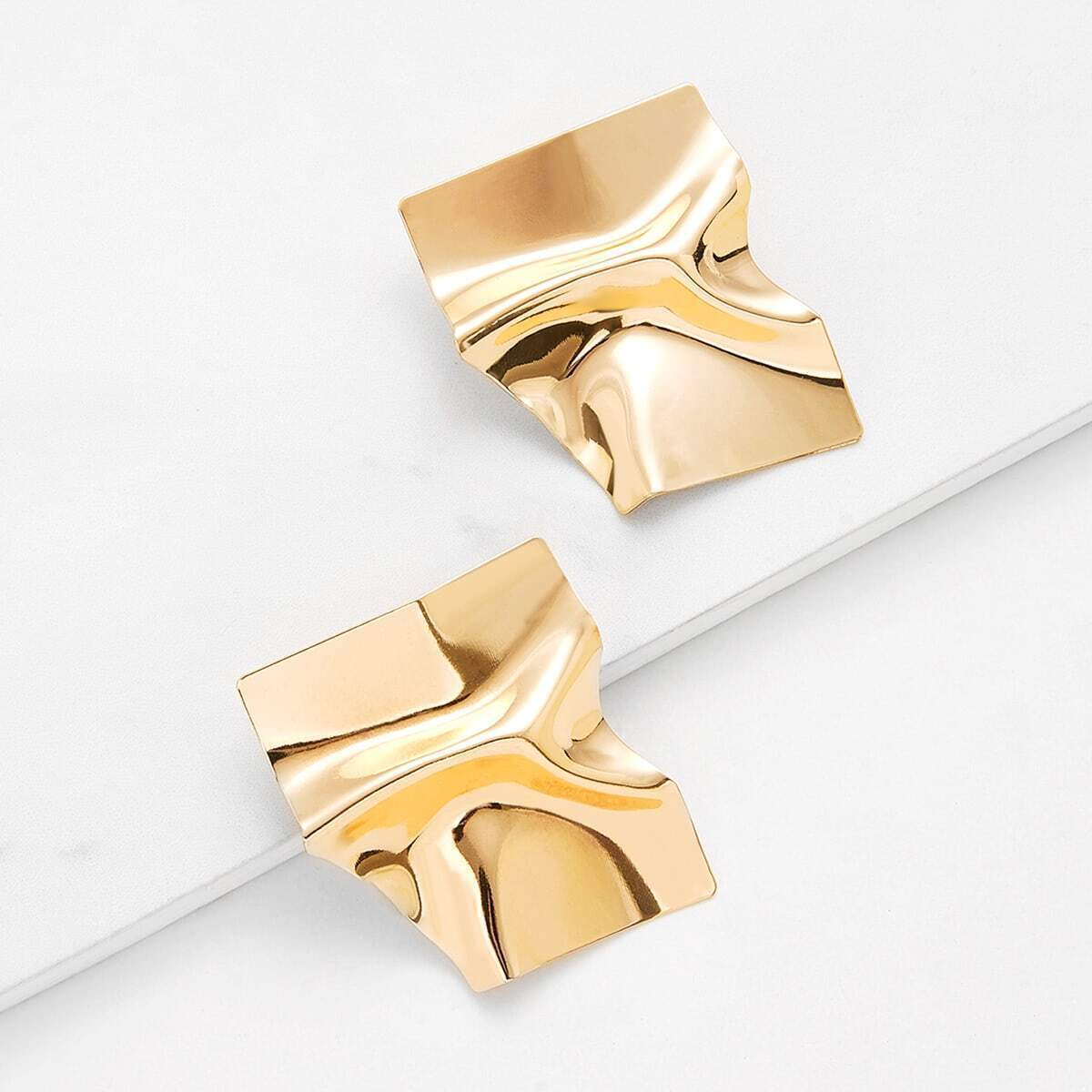- Irregular Shaped Stud Earrings