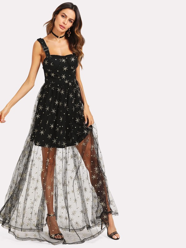 05a44db73fabf فستان بنمط شبك شفاف ومزين بشراشيب